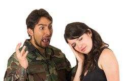 Distraught military soldier veteran ptsd fighting. With wife isolated on white Royalty Free Stock Photo