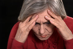 Distraught old woman Stock Photo