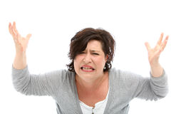 Distraught woman. With her hands raised against white background Stock Images