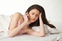 Distraught woman talking on the phone Royalty Free Stock Image