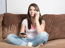 Distraught woman watching television Stock Photos