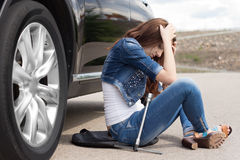Distraught Young Woman Waiting For Assistance Stock Photo