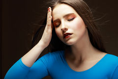 Distress. Woe. Upset Tired Woman Touching her Forehead. Difficulties Stock Photography
