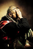 Distressed. Adult distressed man, studio shot, profile Stock Photography