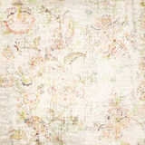 Distressed antique floral and text wallpaper. Vintage distressed background with layers of abstract flowers and handwriting script Royalty Free Stock Photos