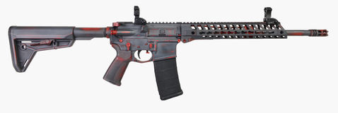 Distressed AR15 grey with red base and controls with a 30rd mag Stock Photo