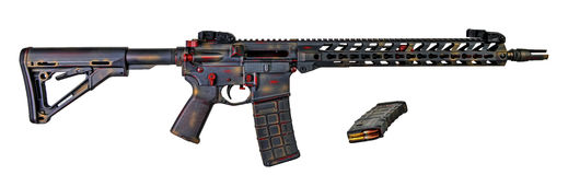 Distressed AR15 / M16 with collapsible stock, 16` barrel. AR15 / M16 distressed grey, ged and gold with collapsible stock with a 30rd mag and a spare loaded with Royalty Free Stock Image