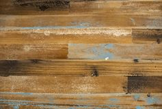 Distressed barn wood background with touches of blue and brown and white paint.  royalty free stock photos