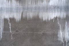 Distressed Brushed Wall. Distress cement whitewash brushed wall texture. Grunge rennovate abstract background. Grainy dirty weathered cover. Empty design Royalty Free Stock Photography