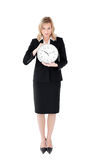 Distressed businesswoman holding a clock Stock Photos