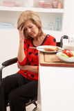 Distressed Disabled Senior Woman Making Sandwich Stock Photo
