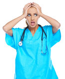 Distressed doctor holding her head Royalty Free Stock Image