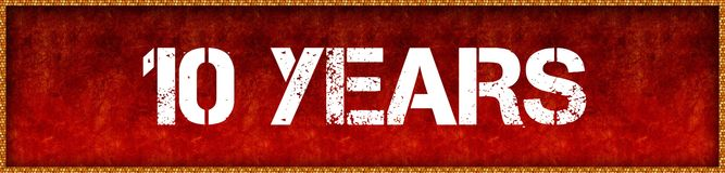 Distressed font text 10 YEARS on red grunge board background. Illustration Royalty Free Stock Images