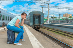 Distressed girl late for his train Royalty Free Stock Images