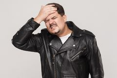 Distressed man have a problem. Touching head and have headache. Indoot shot Royalty Free Stock Image