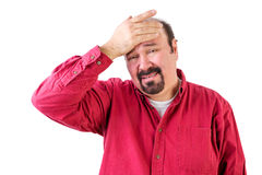 Distressed middle aged man with hand on forehead Royalty Free Stock Photo