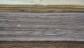 Distressed pages are compacted, compressed in single-sheet stati. Distressed pages in coffee are compacted, compressed in single-sheet stationery. Background Stock Photography