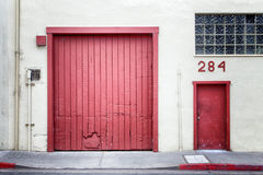 Distressed Red Doors Backdrop or Background Stock Photo
