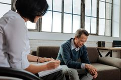 Distressed short-haired old man crying while being in depression. Searching understanding. Distressed short-haired old men crying while being in depression while royalty free stock image