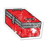 Distressed sticker cartoon doodle of a metal tool box. A creative illustrated distressed sticker cartoon doodle of a metal tool box stock illustration