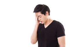Distressed, stressful man thinking, suffering from headache Royalty Free Stock Image