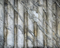 Distressed textured marble abstract background. Distressed textured marble wall in Rome, Italy with repeating striped pattern royalty free stock photo