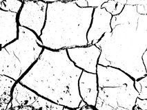The cracks texture of dry earth. Grunge abstract background. Distressed vector overlay. Earth cracks isolated on white Royalty Free Stock Photography