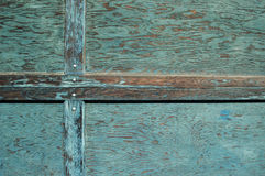 Distressed Wall. Close up of a wooden exterior with distressed paint royalty free stock images
