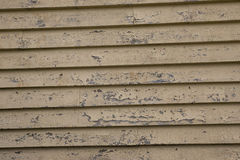 Distressed weatherboard. Close up photo of worn and peeling weatherboards stock photography