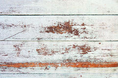 Distressed weathered wood. Distressed weathered painted wood texture close-up as background Royalty Free Stock Photo