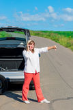 Distressed woman near the broken car Royalty Free Stock Photography