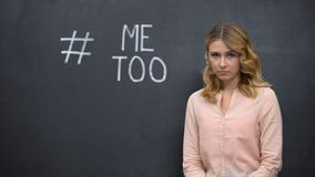 Distressed woman standing near Metoo hashtag, movement against sexual assault. Stock footage stock video