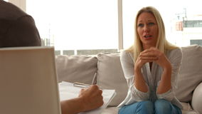 Distressed woman talking to therapist