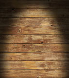 Distressed wooden surface lit dramatically Royalty Free Stock Image