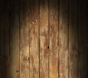 Distressed wooden surface lit dramatically Stock Images