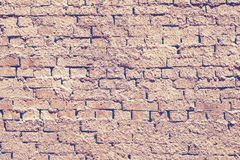 Distressed yellow and orange stone masonry background with clay royalty free stock photography