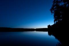 Distretto del lago alla notte Fotografia Stock