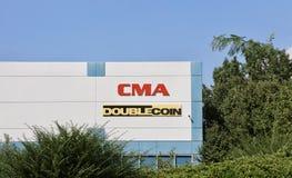 Distribuidor del neumático de la moneda del doble de CMA Imágenes de archivo libres de regalías