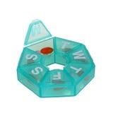 Distribuidor verde do comprimido na forma de uma roda Foto de Stock