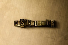 DISTRIBUTE - close-up of grungy vintage typeset word on metal backdrop Stock Image