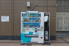 Distributeurs automatiques de diverses sociétés à Tokyo Photo stock