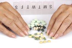Distributing medication into a pill dispenser Stock Photo