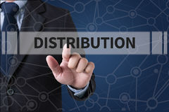 DISTRIBUTION. Businessman hands touching on virtual screen and blurred city background stock photos