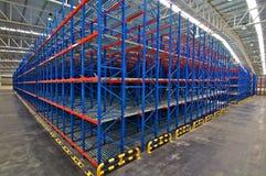 Distribution center warehouse storage shelving system. Distribution center warehouse storage pallet racking system stock photos