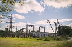 Distribution electric substation with power lines and transformers royalty free stock image