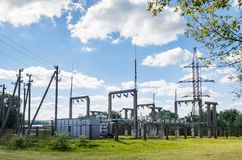 Distribution electric substation with power lines and transformers royalty free stock photos