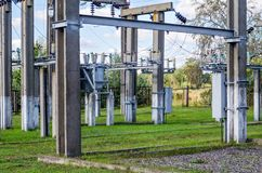 Distribution electric substation with power lines and transformers royalty free stock photo