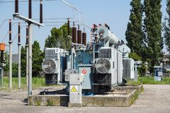Distribution electric substation with power lines and transformers.  royalty free stock photography