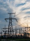 Distribution electric substation with power lines and transformers. At sunset royalty free stock photo