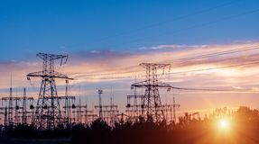 Distribution electric substation with power lines and transformers. At sunset stock photos